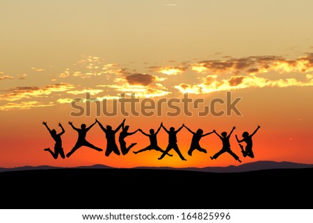 friends jumping in sunset sky
