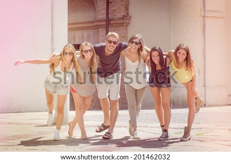 friends leaning together - stock photo