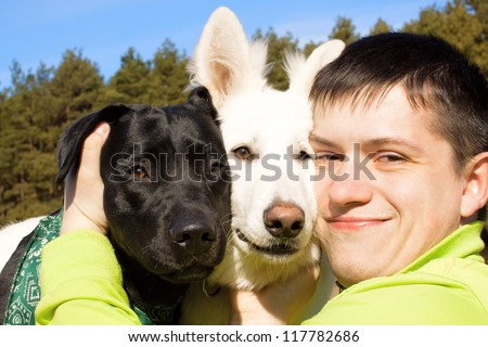 Friends. Man and two his dogs. - stock photo