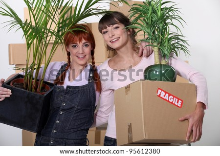 Friends moving house - stock photo