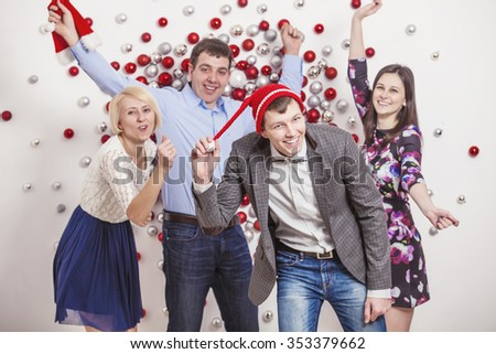 Friends of four men and women are dancing and laughing having fun in Xmas style - stock photo