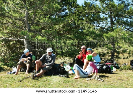 Friends on halt in hike - stock photo