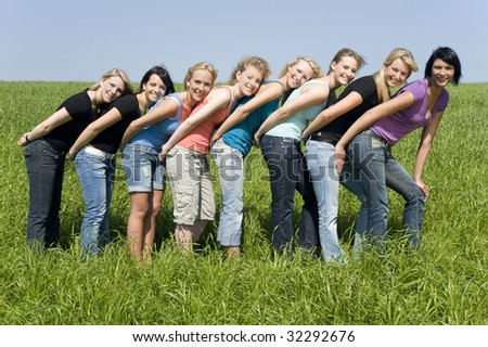 Friends on the meadow - stock photo