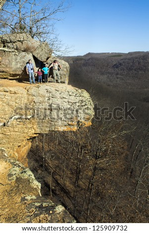 Friends on the rock: two fathers, two sons. Upper Buffalo Wilderness Area - stock photo