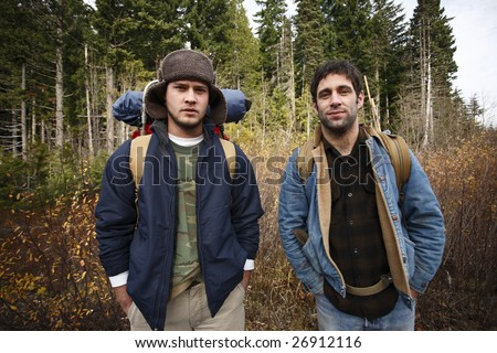 Friends out camping in the great outdoors. - stock photo