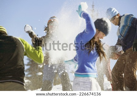 Friends Playing in Snow - stock photo