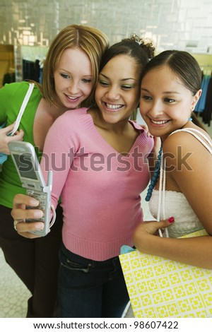 Friends Posing for Camera Phone Picture - stock photo