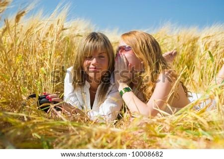 Friends sharing secrets - stock photo