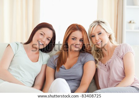 Friends sitting on a sofa in a living room
