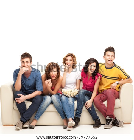 friends sitting on couch laughing hard at comedy movie - stock photo
