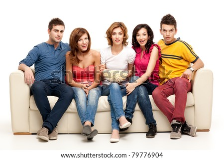 friends sitting on couch watching tv - stock photo