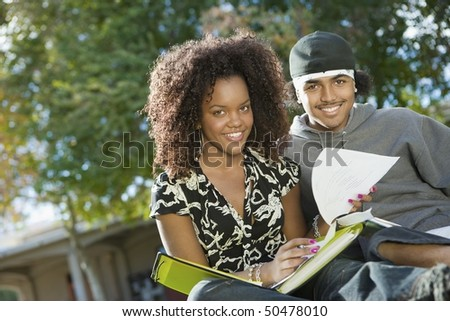 Friends studying outdoors, (portrait) - stock photo