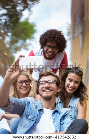 Friends taking selfie on a mobile phone - stock photo