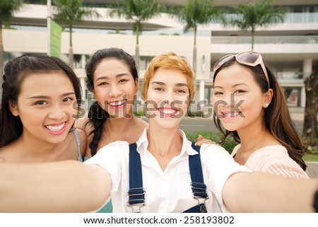 Friends taking selfie outdoors