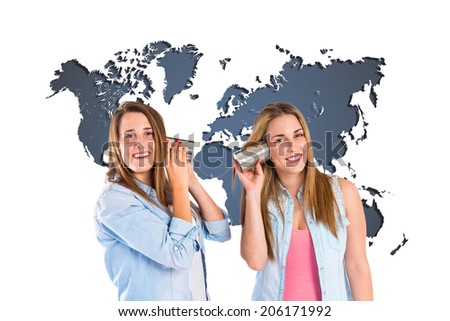 Friends talking through a tin phone over map background - stock photo