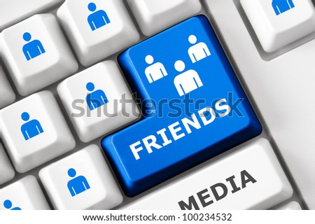 Friends text and people symbols on the modern keyboard. Social media concept - stock photo