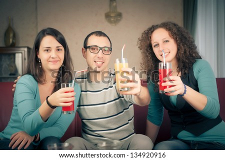 Friends toasting together,Italy - stock photo