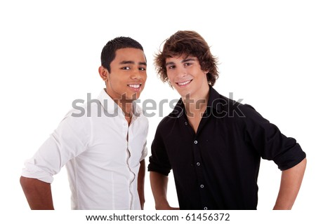 friends: two young man of different colors,looking to camera and smiling, isolated on white, studio shot - stock photo