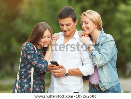 Friends using smartphone - stock photo