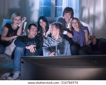 Friends watching a movie. - stock photo