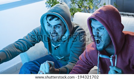 Friends Watching Sport On TV.  - stock photo