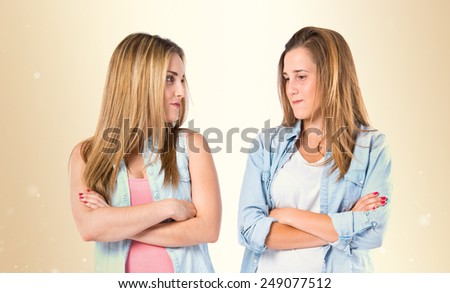 Friends with arms crossed over ocher background