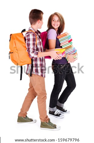 Friends with bunch of books meeting again in school and chatting - stock photo