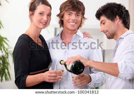 Friends with champagne glasses - stock photo