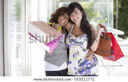 friends with colorful bags - stock photo