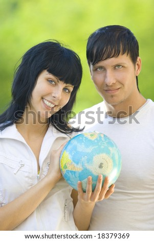 friends with globe have fun - stock photo