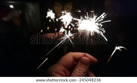 Friends with sparklers. Mobilephoto - stock photo