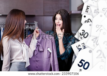 Friends wonder at special prices on sale at the shopping center - stock photo