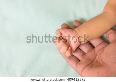 Friendship and binding , baby and old adult hands.