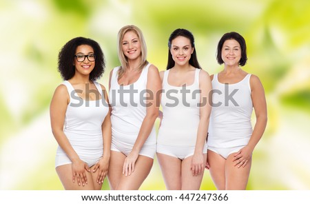 friendship, beauty, body positive and people concept - group of happy women different in white underwear over green natural background