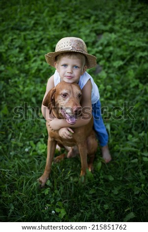Friendship between a child and a dog    - stock photo