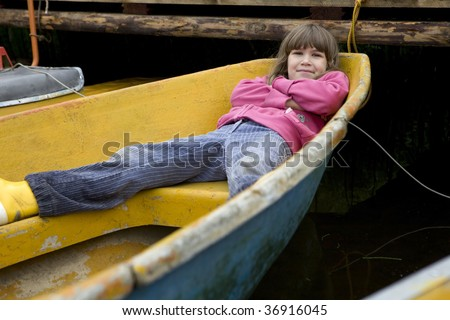 Friendship. Children playing in yellow boat. Summer time - stock photo