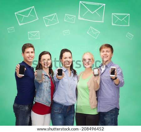 friendship, communication, connection and technology concept - group of smiling students showing smartphone screens - stock photo