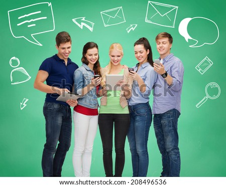 friendship, communication, connection and technology concept - group of smiling students with tablet pc computers and smartphones - stock photo