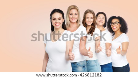 friendship, diverse, body positive, gesture and people concept - group of happy different size women in white t-shirts showing thumbs up over beige background - stock photo