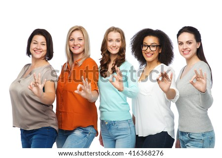 friendship, fashion, body positive, gesture and people concept - group of happy different size women in casual clothes showing ok hand sign