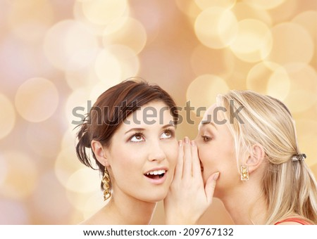 friendship, happiness and people concept - two smiling young women whispering gossip - stock photo