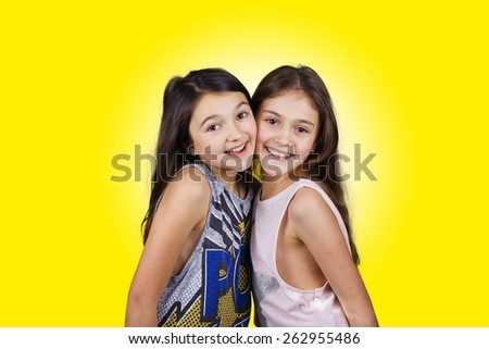 Friendship.Happy smiling two little girls, schoolgirls. - stock photo