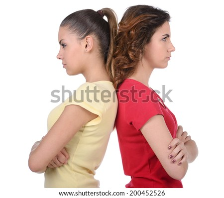 Friendship is over. Two angry women standing back to back and holding their arms crossed while isolated on white - stock photo
