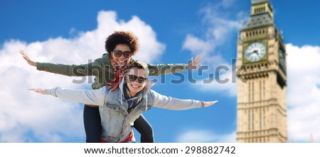 friendship, leisure, international, freedom and people concept - happy teenage couple in shades having fun over london big ben tower background - stock photo