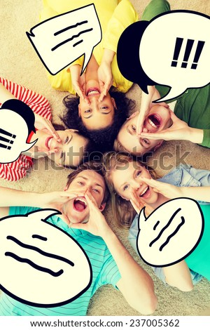 friendship, lifestyle and happiness concept - group of young smiling people lying on floor in circle screaming and shouting - stock photo