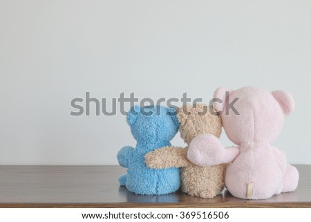 Friendship - two teddy bears holding in one's arms - stock photo