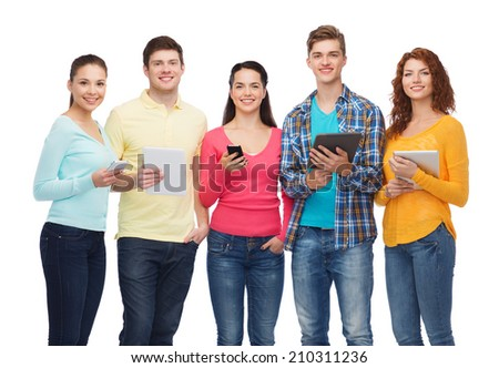 friendship, youth and people concept - group of smiling teenagers with smartphones and tablet pc computers