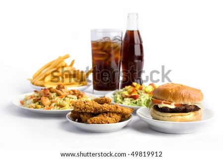 fries, hamburgers, salad with crab meat and cola on white background - stock photo