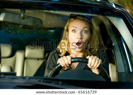 Fright face of  woman driving car and strongly squeeze the wheel - stock photo
