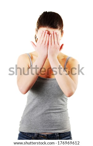 Frighten woman hides her face in hands, isolated on a white background - stock photo